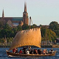 A small viking ship and the cathedral in the background